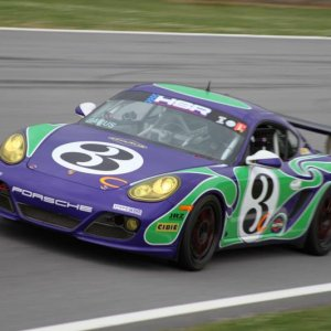"Jim Bacus in the ""Hippy"" Cayman S at Road Atlanta in April, 2010 (Shanna Harbuck Photo)"