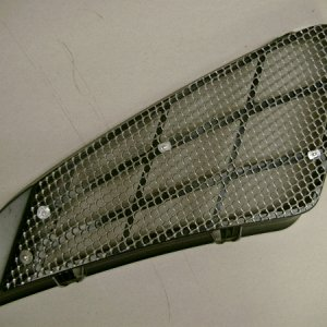 Back side of support piece with mesh attached
